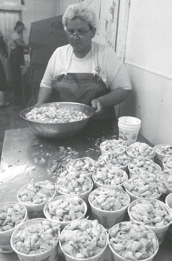 Sea Safari worker packs crabmeat