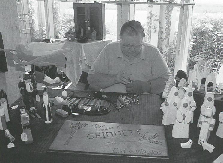 Willie Jimerson with hand-carved items
