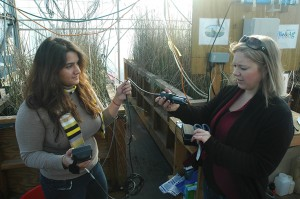 Maggie Rabiipour (left) and Messer (right) show a sensor they use for monitoring the mesocosms. Photo Courtesy Rhett Register.