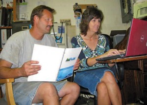 Rusty and April Taylor from Harkers Island work on their business plan after taking the workshops online.