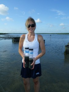 Ashley Smyth collects sediment cores for nitrogen measurements.