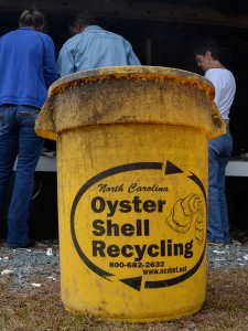Oyster shell recycling bins are placed at the site of the roast.