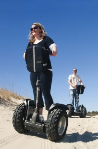 Visitors enjoy segway tours of the beach.