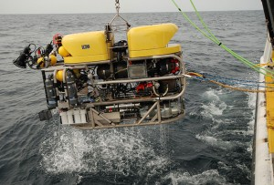The Kraken II ROV being lifted from the ocean.