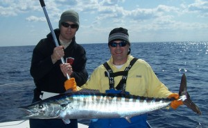 Men hold a large Atlantic wahoo.