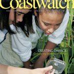 Students examining a tadpole. Courtesy Riverworks at Sturgeon City