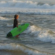 woman heads to surf