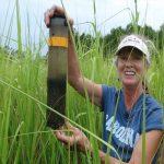 Suzanne Thompson holds sediment core.