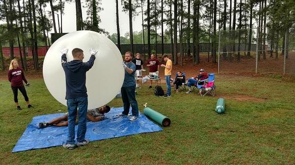 students test balloon launch