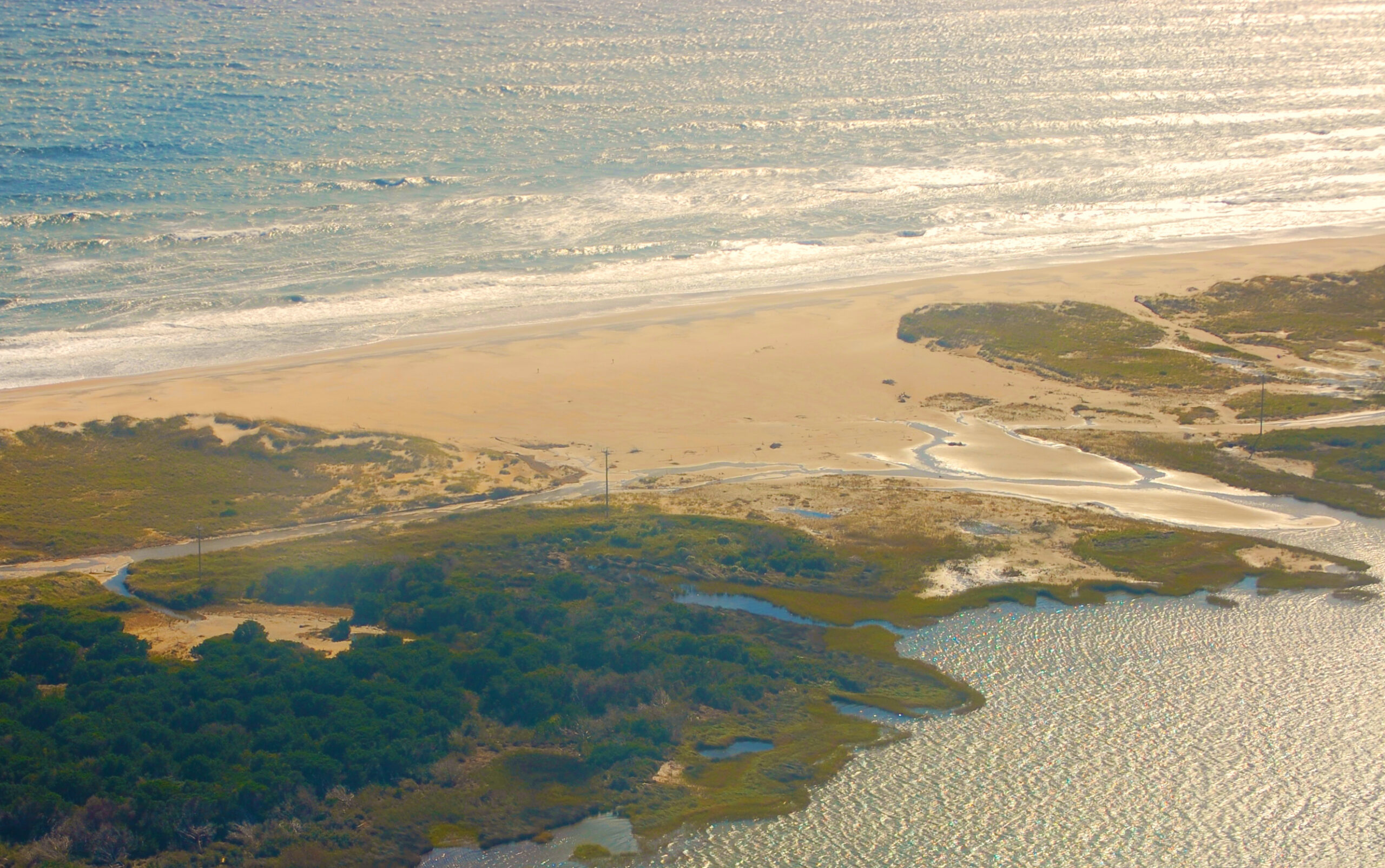 Coastal change increasingly confronts Hatteras Island residents with trouble spots like the one along NC 12 (lead photo), which Hurricane Irene caused, as well as new inlets and flooding from storms like Sandy. Both photos courtesy of NC DOT/CC BY 2.0.