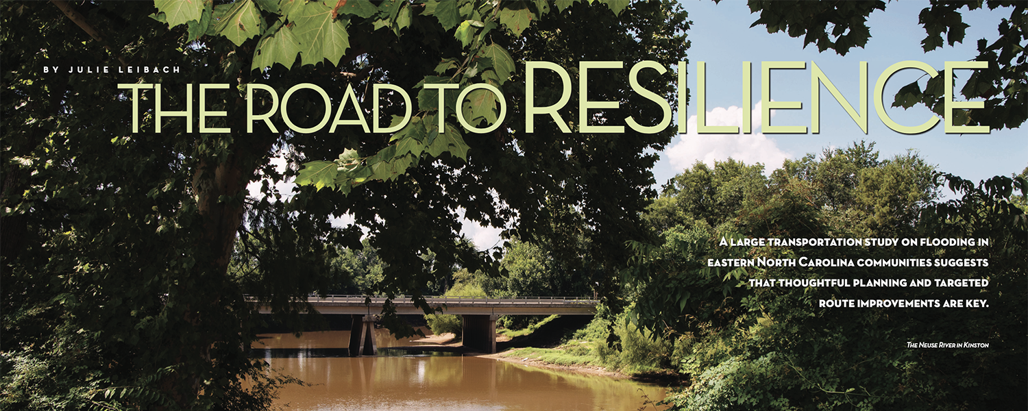 """Photo of a bridge crossing over the Neuse River in Kinston. The title of the article, """"The Road to Resilience,"""" overlays the photo, along with the author's name, Julie Leibach."""
