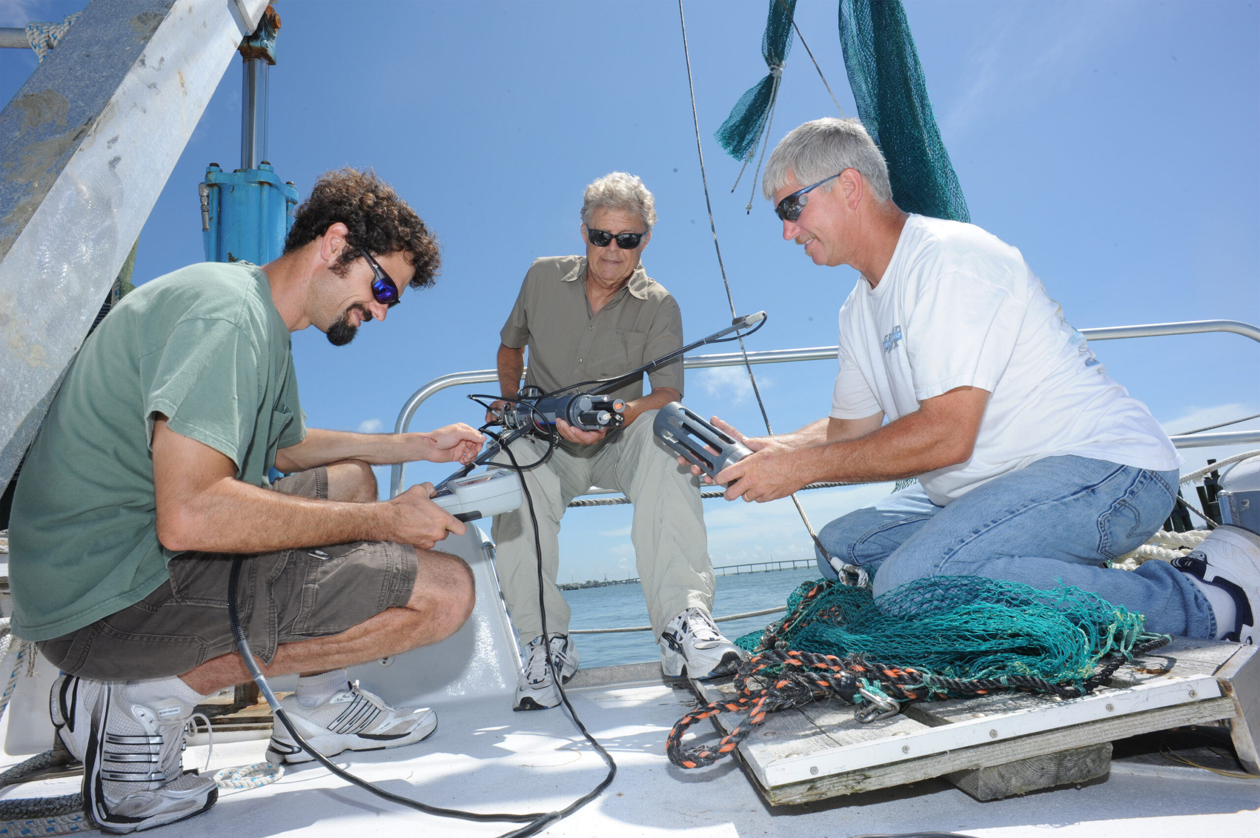 Scientist Hans Pearl (center) and colleagues on a FerryMon route to collect vital water quality data from the Neuse River Estuary and Pamlico Sound. Photo courtesy of UNC.