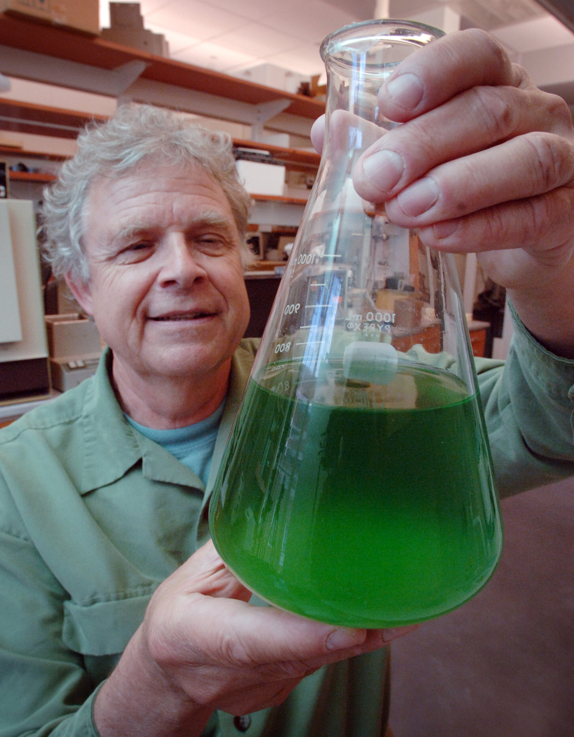 Hans Paerl with algae bloom in hand. Photograph courtesy of UNC.
