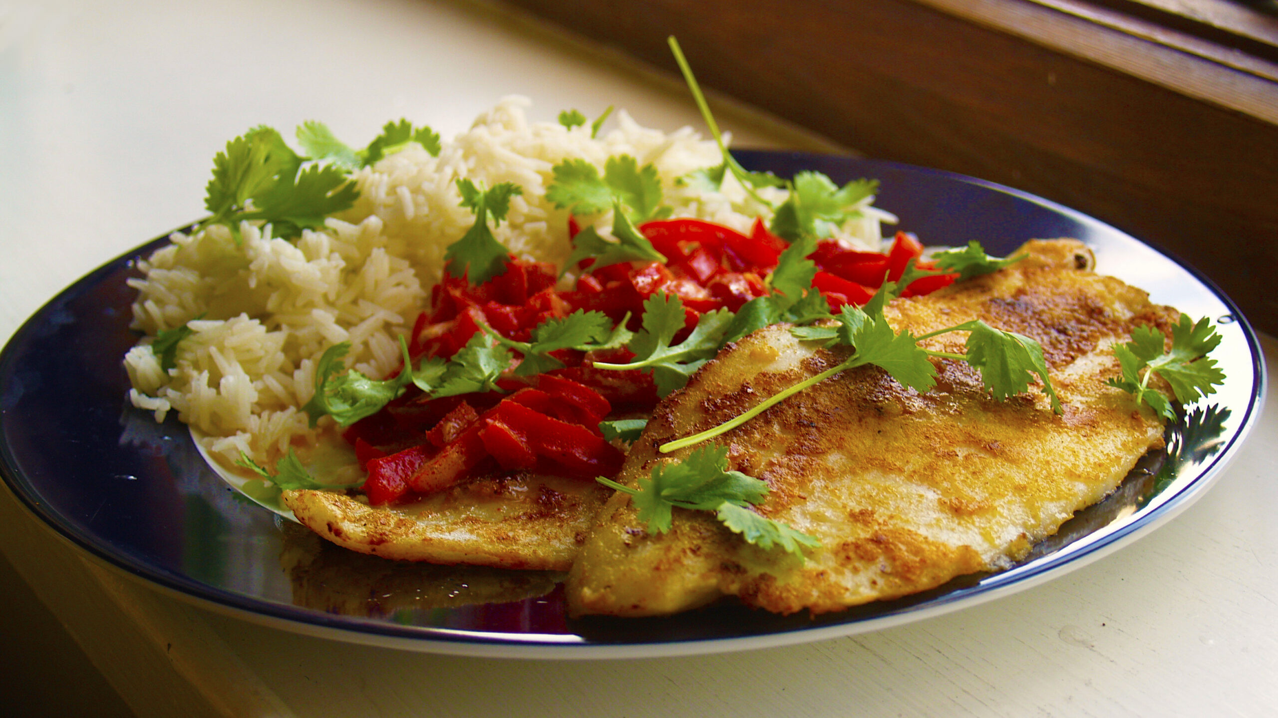 Pangasius with rice and red pepper. Credit: cyclonebill/CC BY-SA 2.0