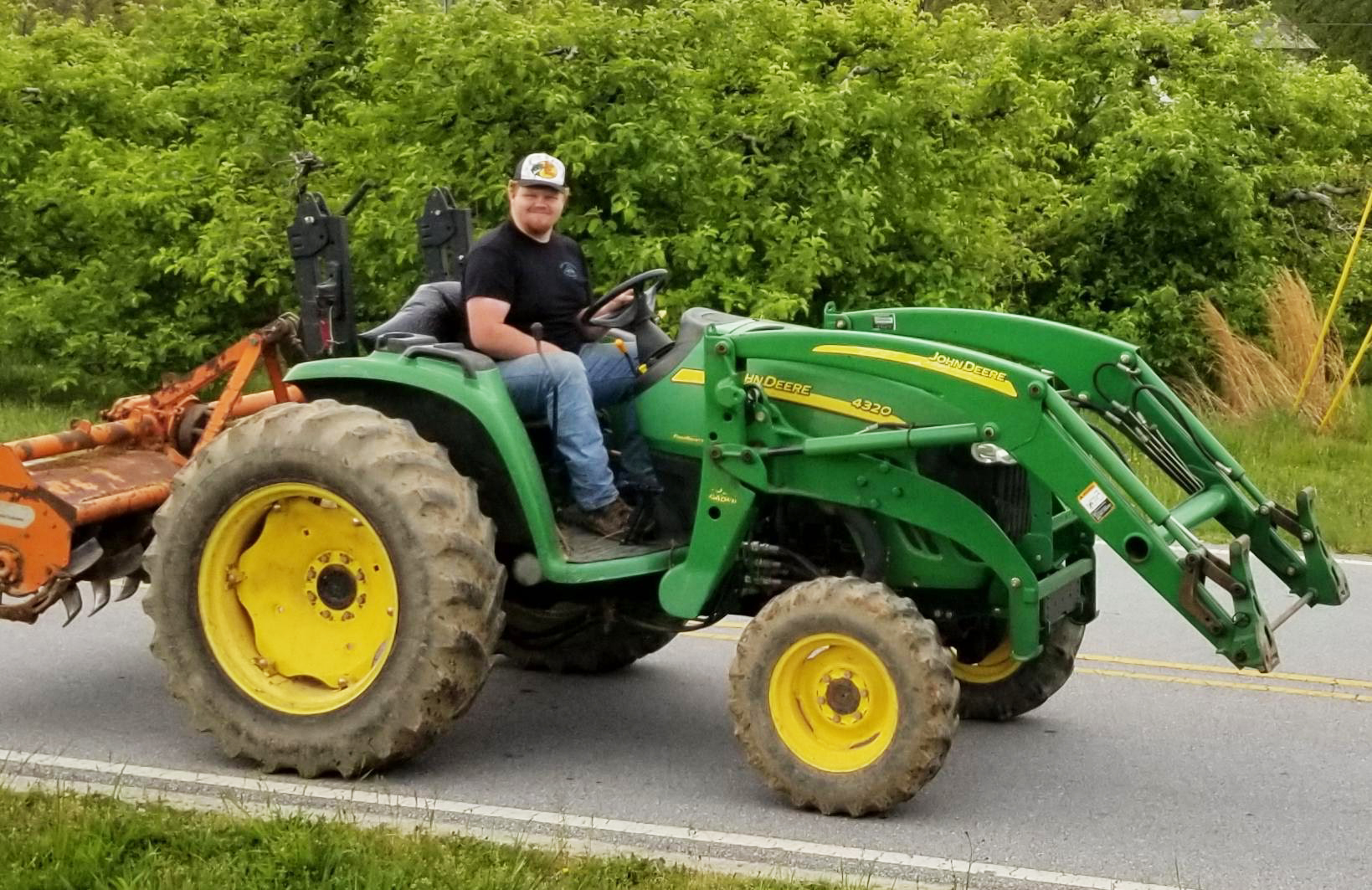 Aaron Corn on a tractor