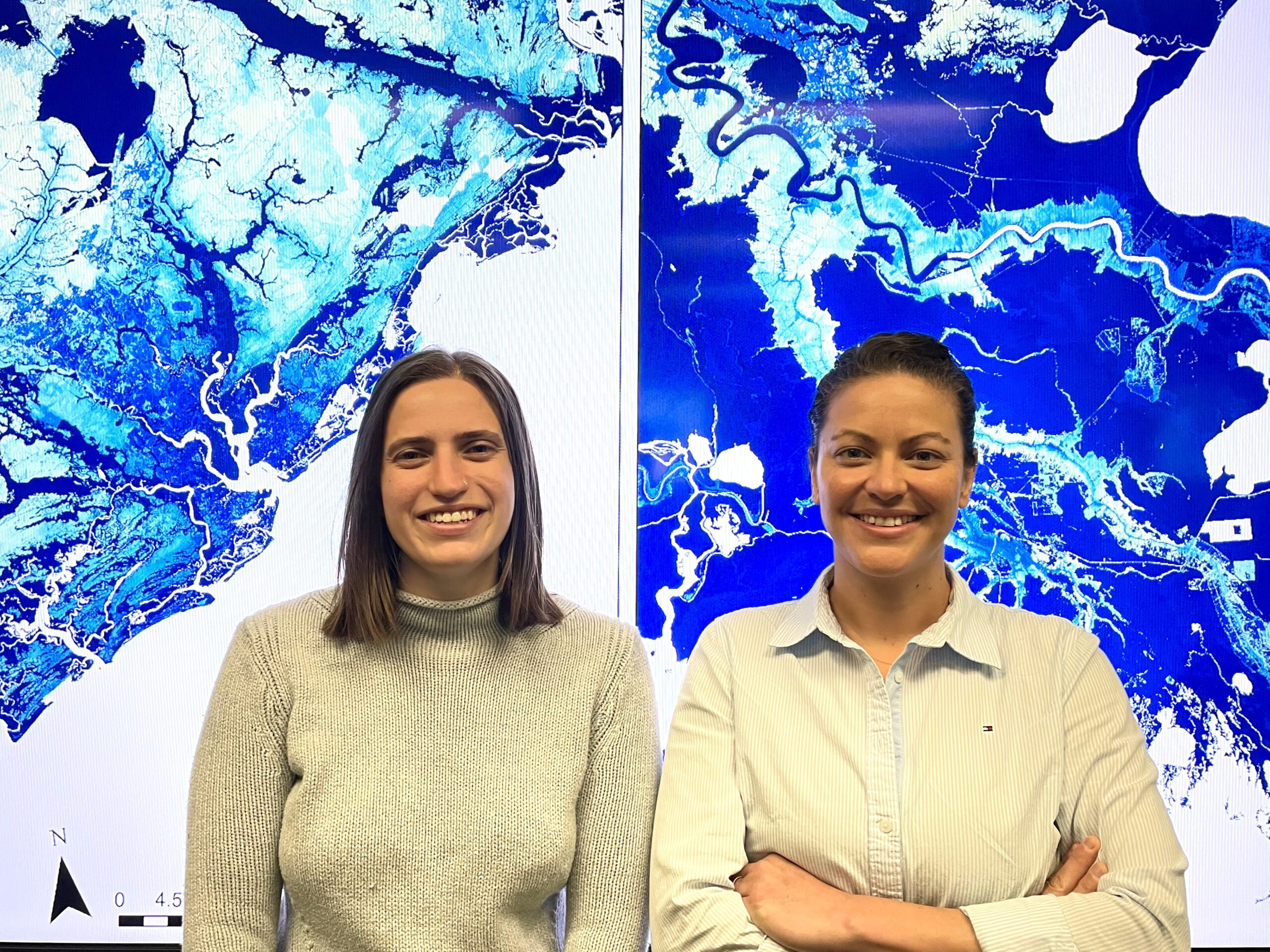 Georgina Sanchez (right) and Elyssa Collins (left) at the Center for Geospatial Analytics are developing state-of-the-art flood mapping that accounts for different climate change scenarios. Credit: NC State's College of Natural Resources.
