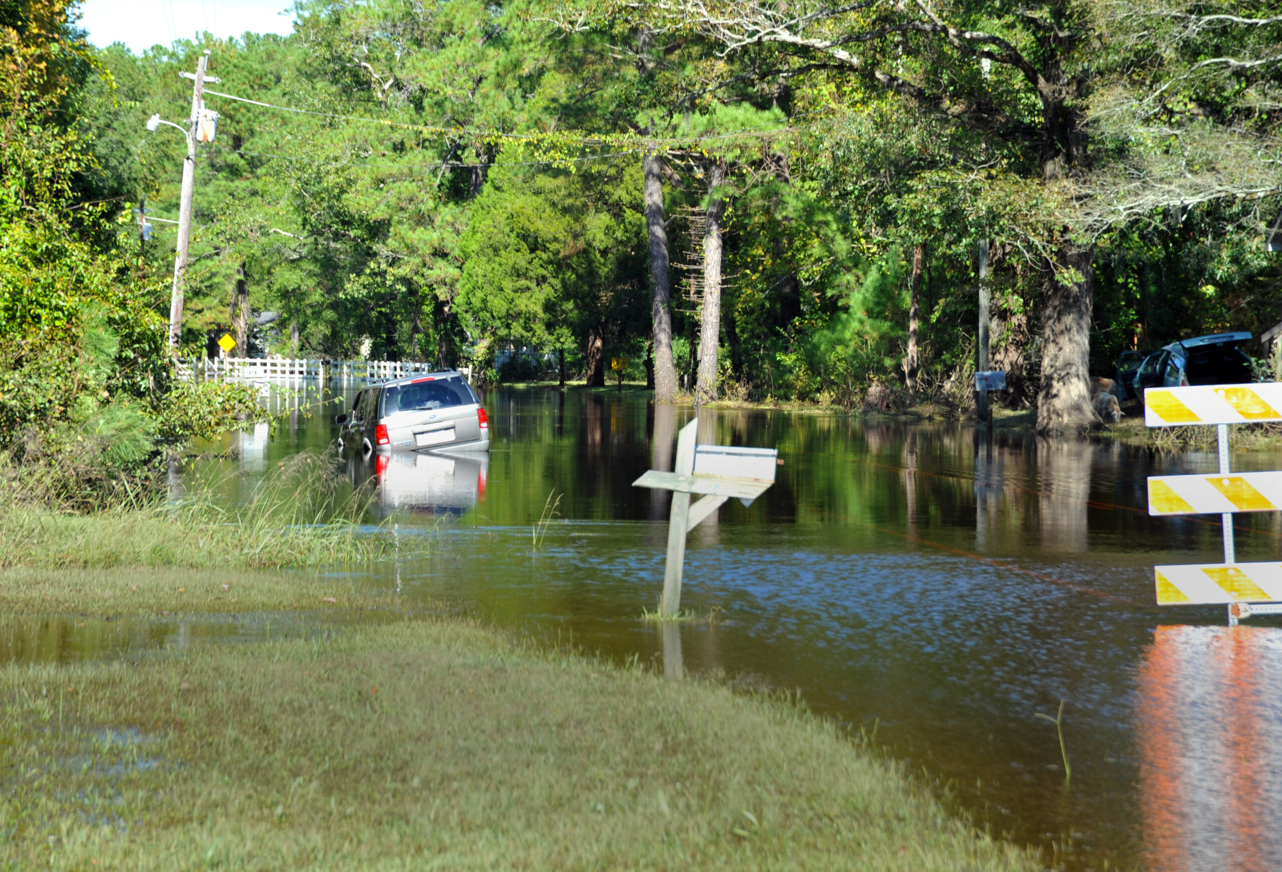 Many communities have experienced increased flooding over the last few decades and will continue to do so as the rising temperatures shift rainfall patterns and exacerbate weather events. Vanceboro, 2010, after Tropical Storm Nicole. Credit: Tim Burkitt/FEMA.