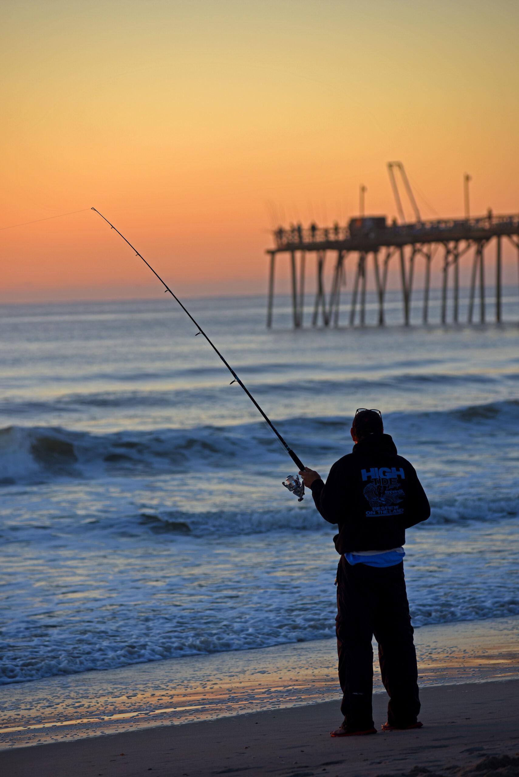 Fishing the surf at sunrise at Carolina Beach.