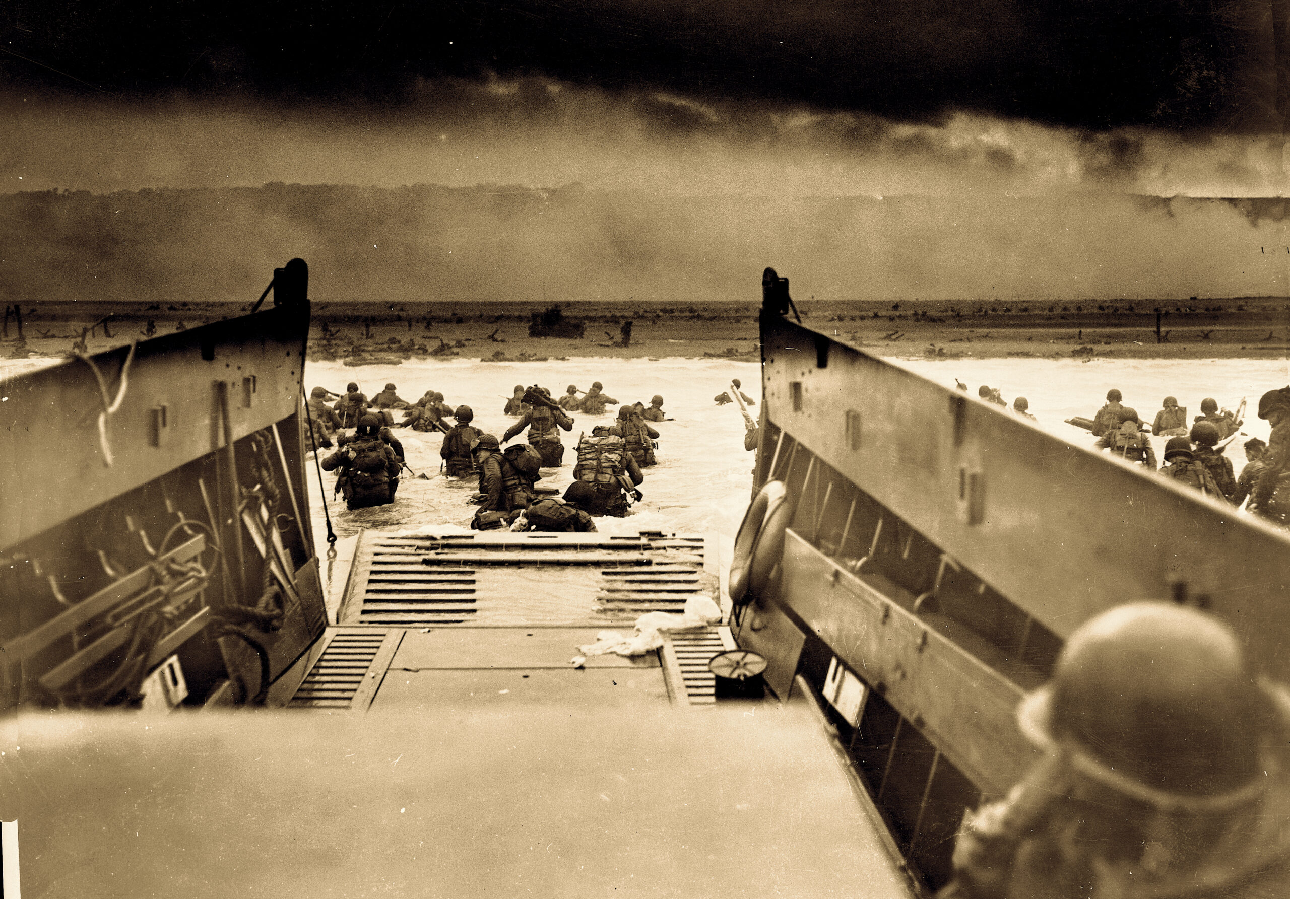 On D-Day, Harkers Island's Donald Willis piloted a Coast Guard landing craft, like the one in this picture of Normandy on that fateful June 6. Willis took cannon fire, which left his boat dead in the water. He swam to a nearby craft — its pilot fatally shot — and took more soldiers ashore. Courtesy of theLibrary of Congress.