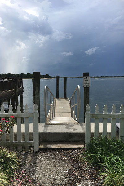Fence, dock and water at Taylor's Creek in Beaufort