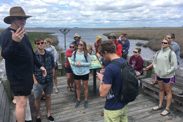 Group of people on marsh edge