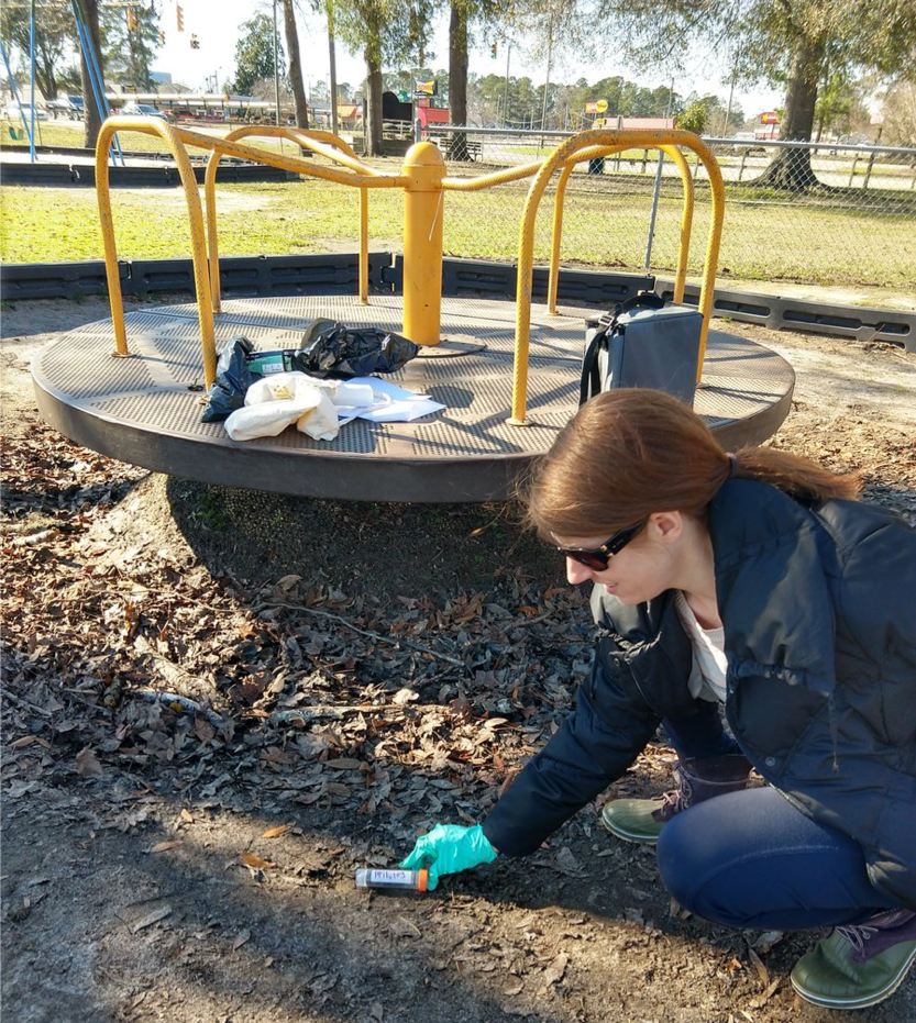 Researcher Laura Bray collecting soil for E.coli testing at Jerry Giles Park in Lumberton, NC.