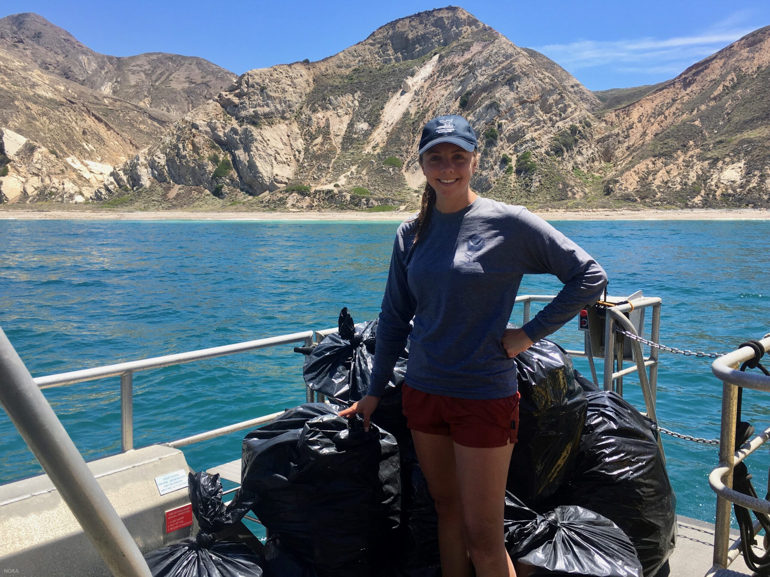 Laura Ingulsrud coordinates a shoreline cleanup on Santa Cruz Island as part of her internship with the Channel Islands National Marine Sanctuary.