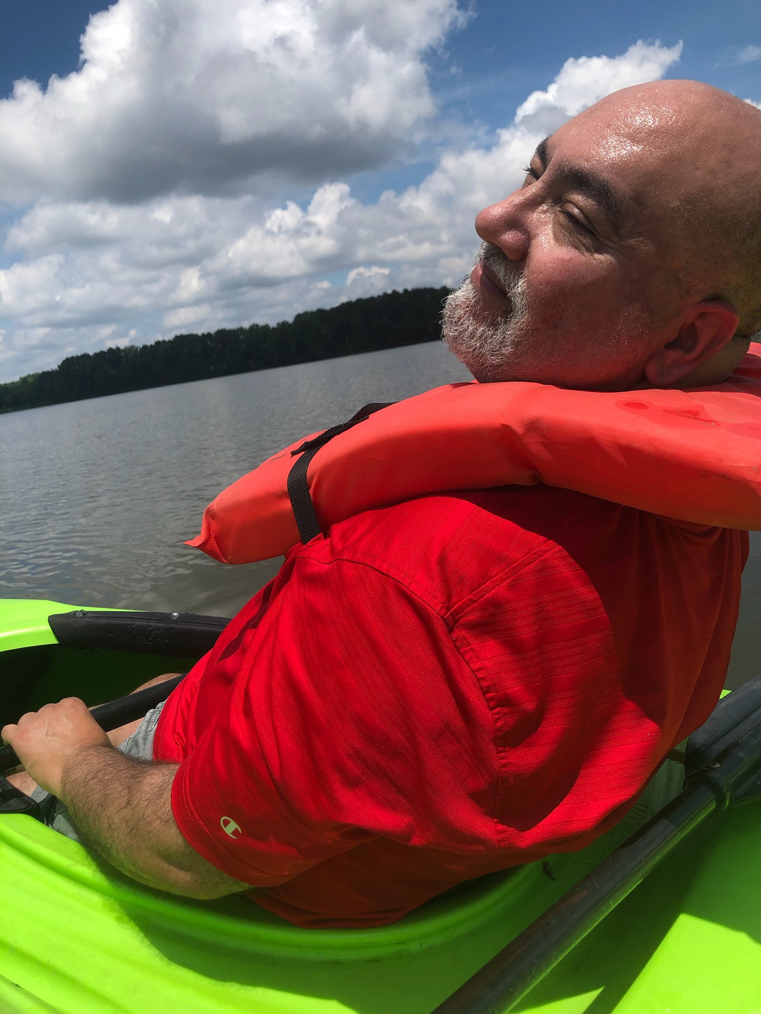 Frank Lopez, extension director for North Carolina Sea Grant and the NC Water Resources Research Institute, kayaks on a lake in Garner, N.C.
