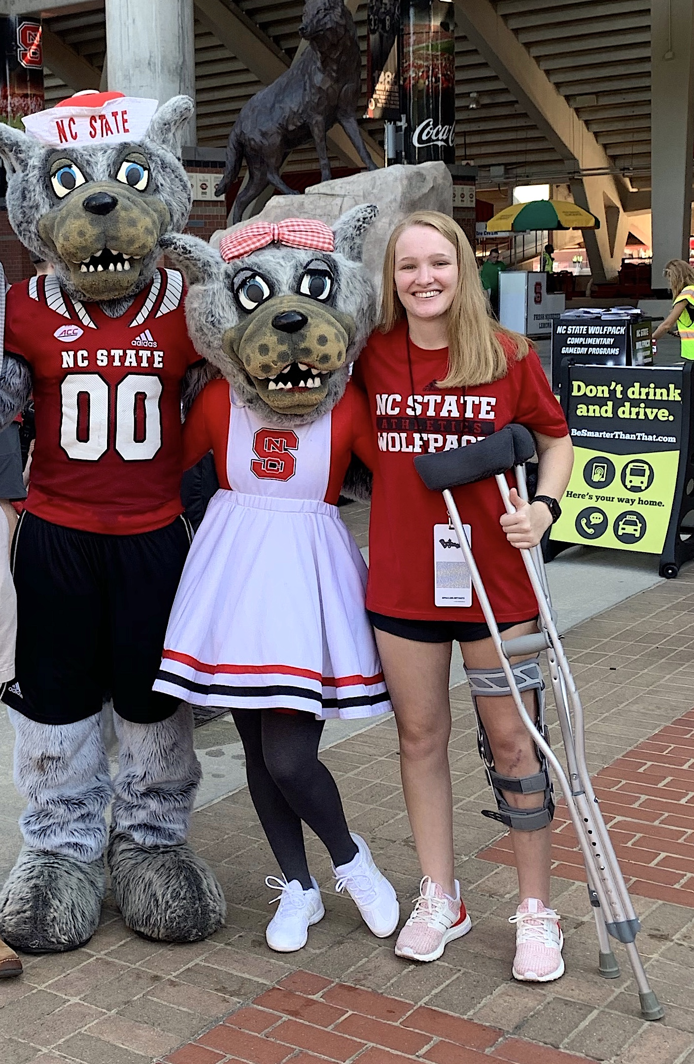 Reagan Perry, with a couple of NC State icons.