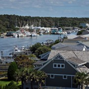 Boats, houses along waterfront.