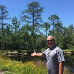 Wilmington homeowner in front of stormwater pond_by Jane Harrison