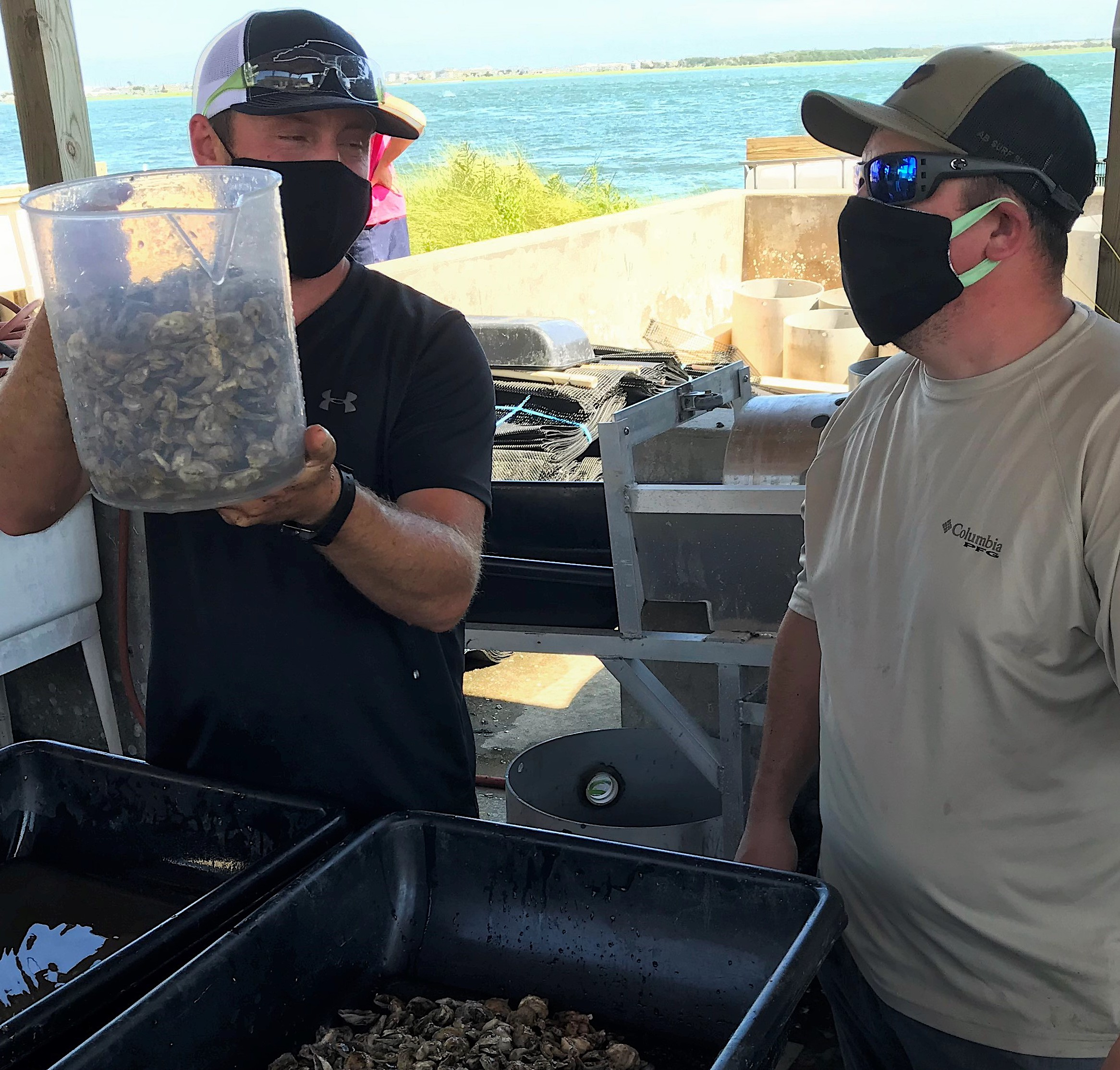 Instructor Bryan Snyder shows students how to count oyster seed.