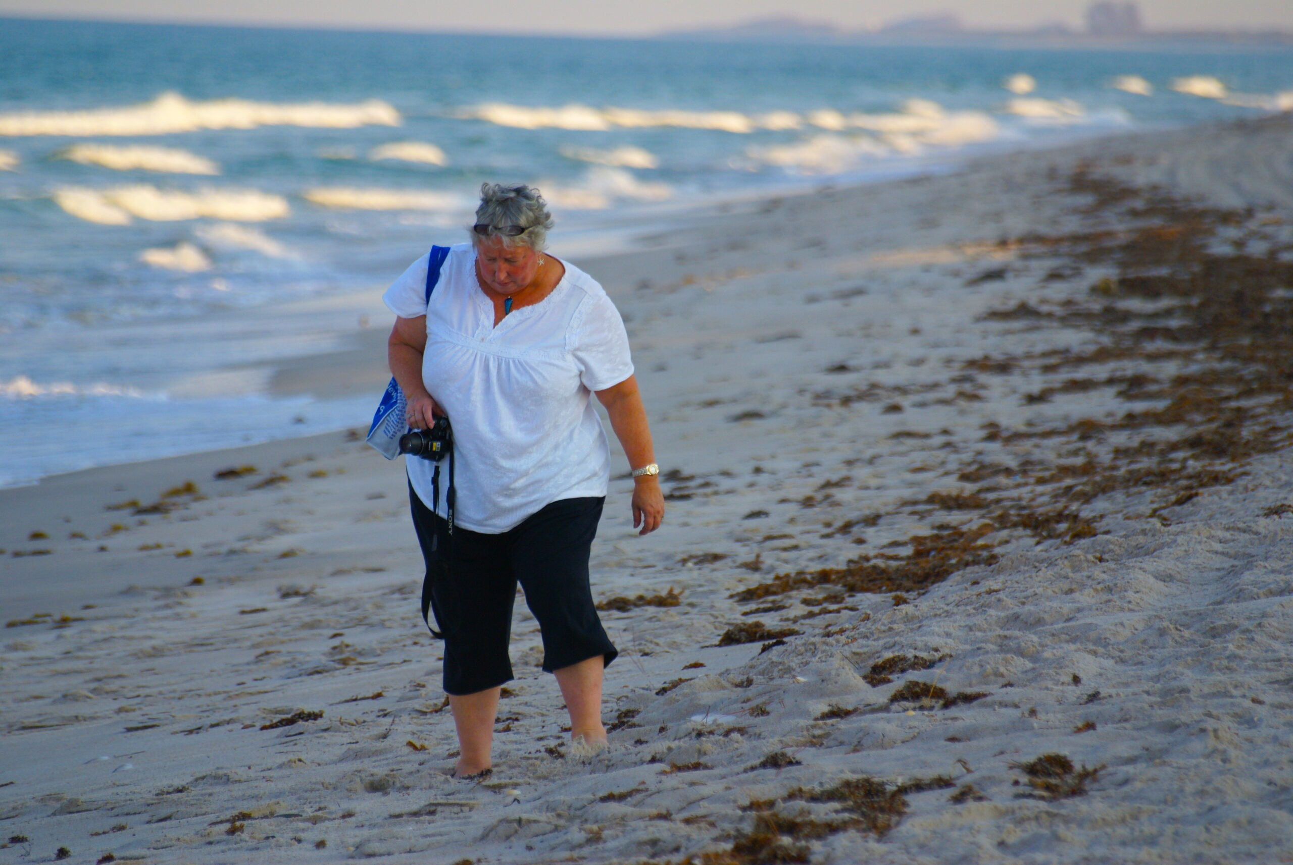 Terri Kirby Hathaway walking along the beach.