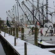 Boats on Harkers Island in snow.