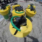 Data-logging drifters with yellow tops, green bodies and tubing, and GPS devices.