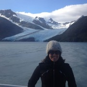 Woman on boat close to glacier