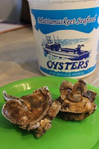 Oyster clusters on a plate and Mattamuskeet Seafood container