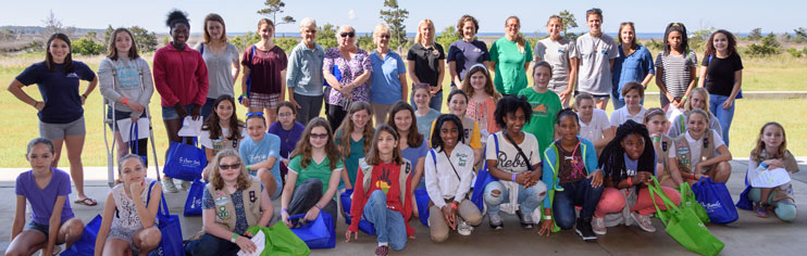 Group photo of women researchers and Girl Scouts