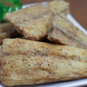 fried spanish mackerel backbones on plate