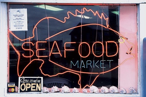 Seafood market sign in the shape of a fish